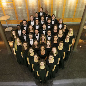 36 students, standing in a diamond formation looking up at the camera, wearing black formalwear