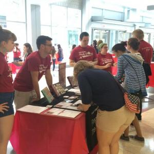 Students speak with Peer Advisors at an Info Table
